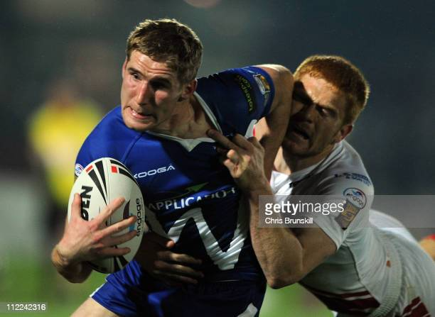 Sam Tomkins of Wigan Warriors is tackled by Kris Welham of Hull Kingston Rovers during the Engage Super League match between Hull Kingston Rovers and...