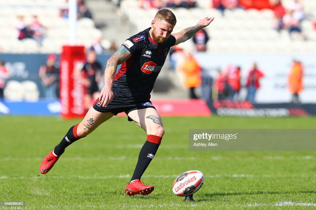Sam Tomkins of Wigan Warriors kicks at goal during round six of the Ladbrokes Challenge Cup at KCOM Craven Park on May 13, 2018 in Hull, England.