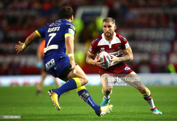 Sam Tomkins of Wigan Warriors runs with the ball during the BetFred Super League Grand Final between Warrington Wolves and Wigan Warriors at Old...
