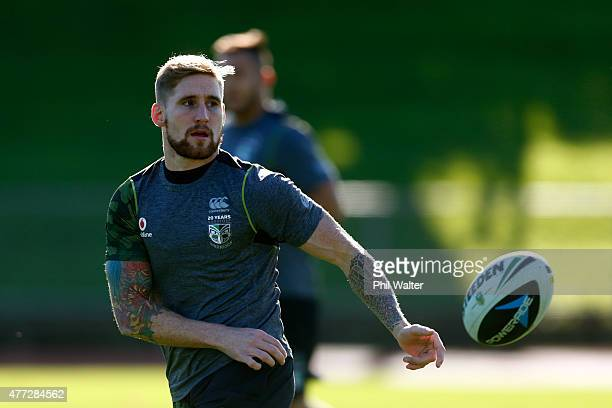 Sam Tomkins passes the ball during a New Zealand Warriors NRL training session at Mt Smart Stadium on June 16 2015 in Auckland New Zealand