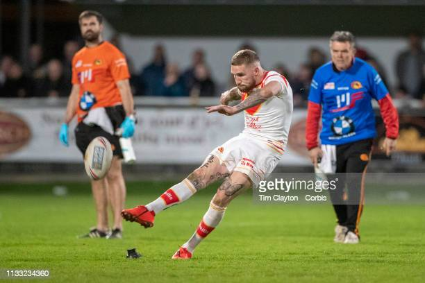 Sam Tonkins of Catalans Dragons kicks the winning penalty late in the match during his sides 2322 win during the Catalans Dragons V Warrington Wolves...