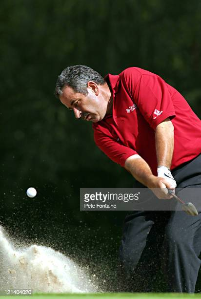Sam Torrance blasts out of the greenside bunker on the 16th hole during the first round of the Travis Perkins Senior Masters at the Wentworth Golf...