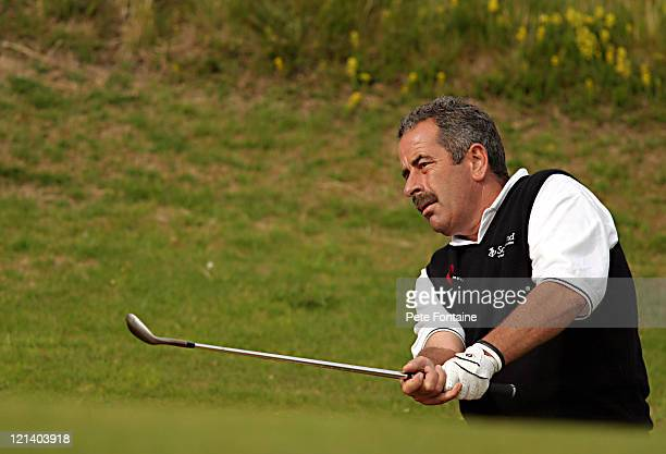 Sam Torrance chips to the green during the second round of the Senior British Open at the Royal Portrush Golf Club July 23 2004