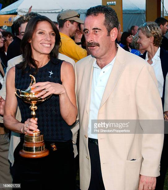 Sam Torrance nonplaying captain of the European team for the Ryder Cup golf competition with his wife Suzanne Danielle and the Cup after his team's...