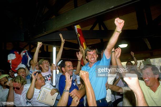 Sam Torrance of Scotland and Nick Faldo of England celebrate with some of their supporters after winning the Ryder Cup at Muirfield Village in Ohio,...
