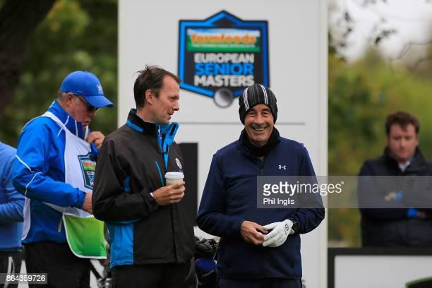Sam Torrance of Scotland chats to David MacLaren Head of European Senior Tour during the second round of the Farmfoods European Senior Masters played...