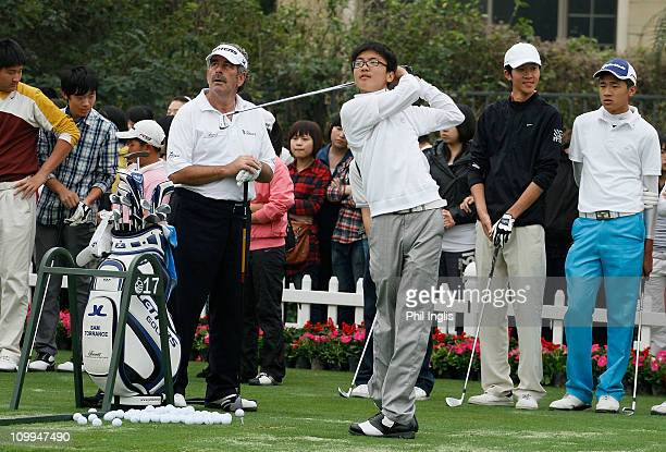 Sam Torrance of Scotland teaches a junior at the Legends Clinic after the first round of the ISPS Handa Senior World Championship presented by...