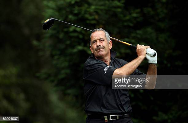 Sam Torrance of Scotland tees off on the ninth hole during the first round of The Senior Open Championship presented by MasterCard held on the Old...