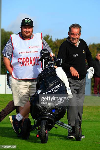 Sam Torrance of Scotland with his son Daniel during the first round of the Dutch Senior Open played at The International on October 10 2014 in...