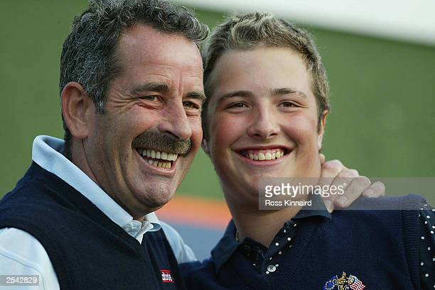 Sam Torrance of Scotland with his son Daniel who were the winning proam team after the final round of the Dunhill Links Championship on September 28...