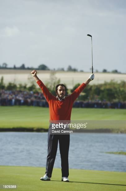 Sam Torrance of the European Team celebrates after sinking a putt to seal victory over the United States of America during the Ryder Cup held at The...