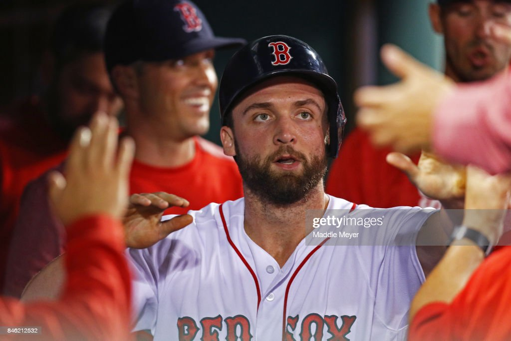 Sam Travis #59 of the Boston Red Sox celebrates in the dugout after scoring a run against the Oakland Athletics during the second inning at Fenway Park on September 12, 2017 in Boston, Massachusetts.