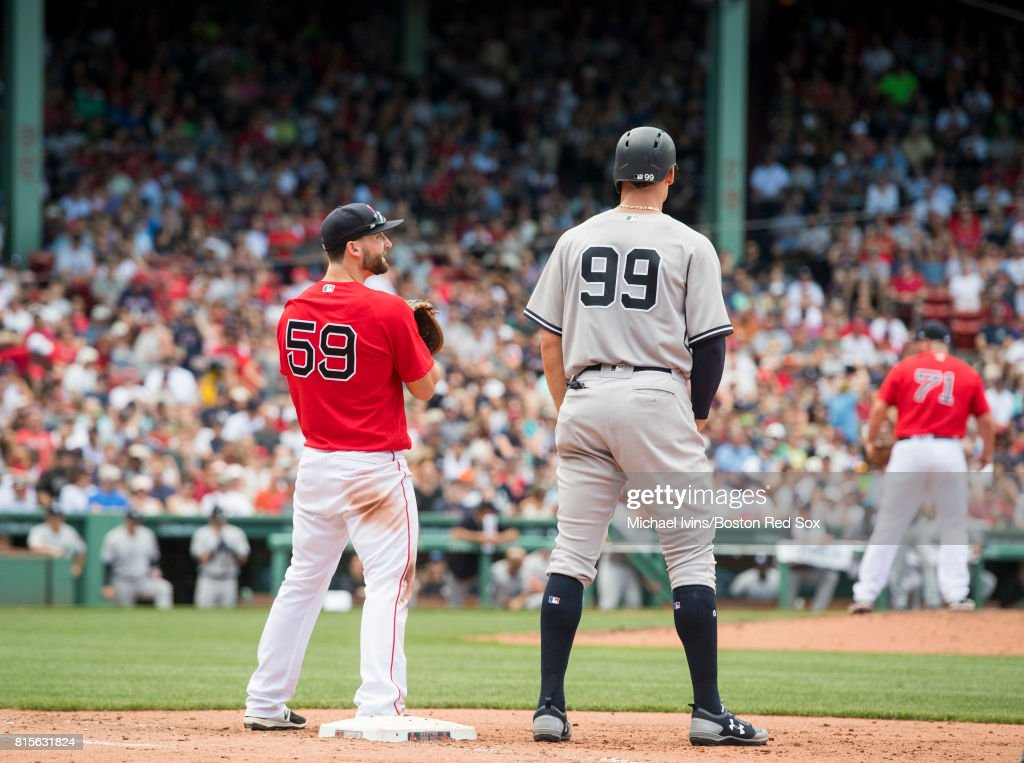 Sam Travis #59 of the Boston Red Sox looks up to Aaron Judge #99 of the New York Yankees in the sixth inning during game one of a doubleheader at Fenway Park on July 16, 2017 in Boston, Massachusetts.