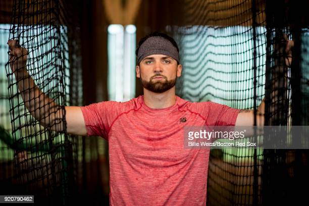 Sam Travis of the Boston Red Sox poses for a portrait in the batting cage during a team workout on February 19 2018 at jetBlue Park at Fenway South...