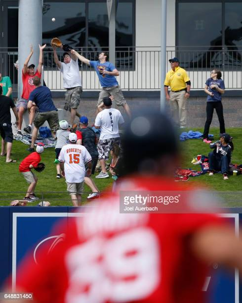 Sam Travis of the Boston Red Sox watches fans catch his three run home run ball in left field against the Houston Astros in the third inning during a...