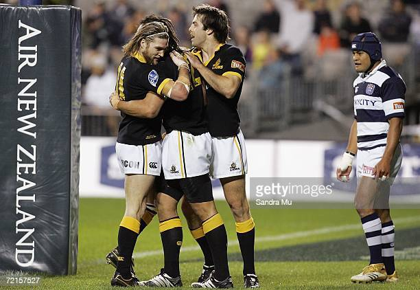 Sam Tuitupou of Auckland looks on as Cory Jane and Conrad Smith of Wellington hug try scorer Tana Umaga during the Air New Zealand Cup semifinal...