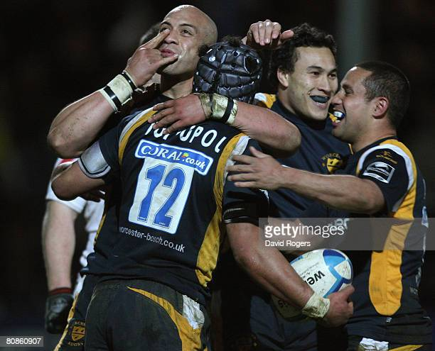 Sam Tuitupou of Worcester celebrates with team mate Kai Horstmann after scoring a try during the European Challenge Cup semi final match between...