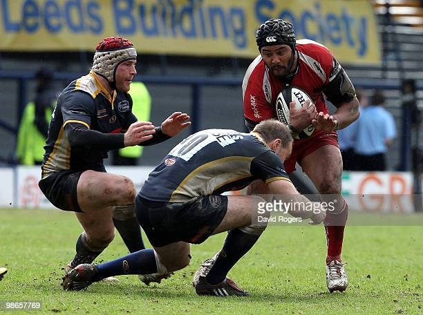 Sam Tuitupou of Worcester is stopped by Andy Titterrell and Ceiron Thomas during the Guinness Premiership match between Leeds Carnegie and Worcester...