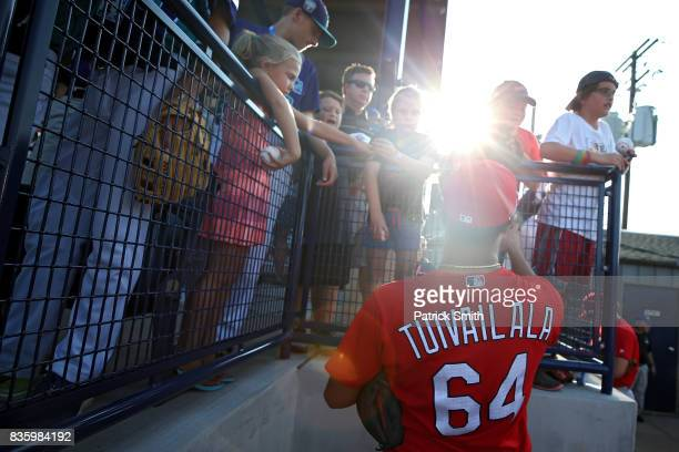Sam Tuivailala of the St Louis Cardinals and teammates sign autographs for Little League players before playing against the Pittsburgh Pirates in the...