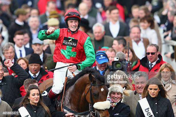 Sam TwistonDavies celebrates after riding Dodging Bulletts to victory in the Betway Queen Mother Champion Steeple Chase during day two of the...