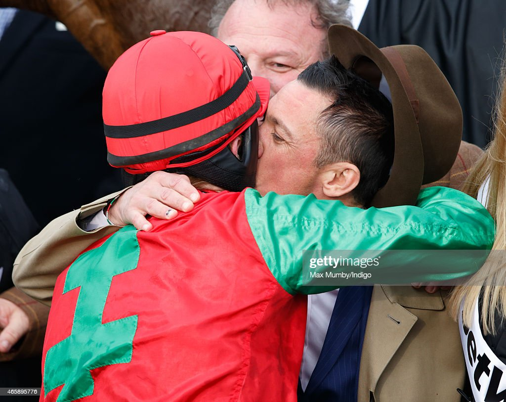 Sam Twiston-Davies kisses Frankie Dettori (breeder of Dodging Bullets) after winning the Queen Mother Champion Steeple Chase on day 2 of the Cheltenham Festival at Cheltenham Racecourse on March 11, 2015 in Cheltenham, England.