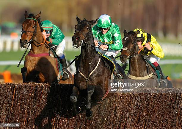 Sam TwistonDavies riding Astracad clear the last to win The Jenny Mould Memorial Handicap Steple Chase at Cheltenham racecourse on December 10 2011...