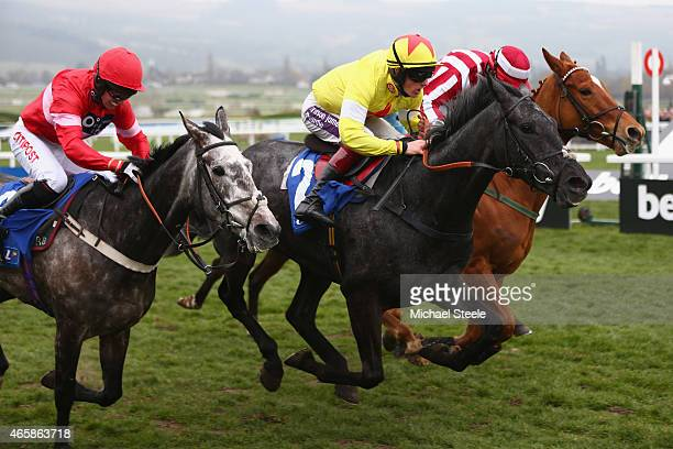 Sam TwistonDavies riding Aux Ptits Sons on his way to victory from Noel Fehily riding Actival and Robert Colgan riding Zabana in the Coral Cup Hurdle...