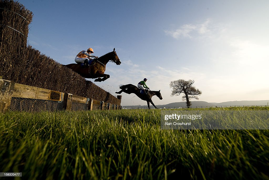 Sam Twiston-Davies riding Changing Times (L) on their way to winning The Remembering Victor Thorne Novices' Limited Handicap Steeple Chase at Taunton racecourse on December 13, 2012 in Taunton, England.