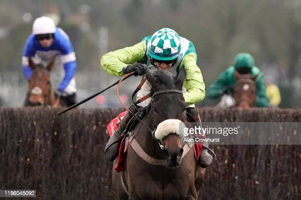 Sam Twiston-Davies riding Clan Des Obeaux clear the last to win The Ladbrokes King George VI Chase at Kempton Park Racecourse on December 26, 2019 in...