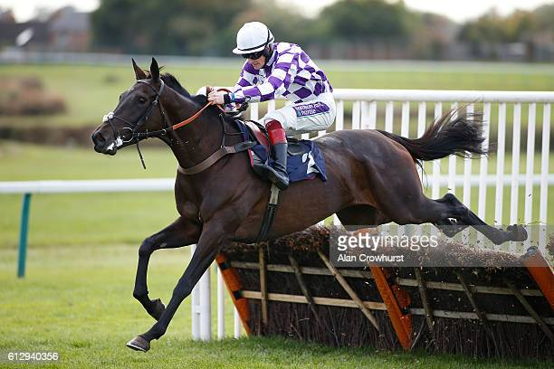 Sam TwistonDavies riding Coillte Lass clear the last to win The bet365com Mares' 'National Hunt Maiden Hurdle Race at Hereford racecourse on October...