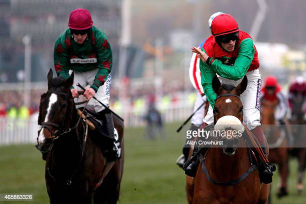 Sam TwistonDavies riding Dodging Bullets celebrate winning The Betway Queen Mother Champion Steepel Chase at Cheltenham racecourse on March 11 2015...