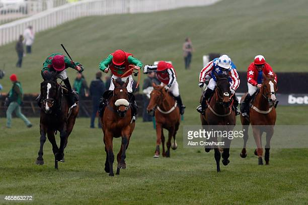 Sam TwistonDavies riding Dodging Bullets win The Betway Queen Mother Champion Steepel Chase at Cheltenham racecourse on March 11 2015 in Cheltenham...