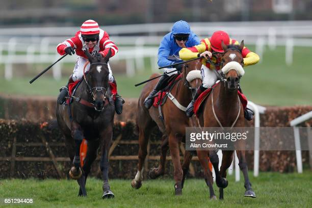 Sam TwistonDavies riding Goodbye Dancer clear the last to win The Team Army Handicap Hurdle Race at Sandown Park on March 10 2017 in Esher England