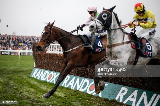 Sam TwistonDavies riding Politologue clear the last to win The JLT Melling Chase from Min at Aintree racecourse on April 13 2018 in Liverpool England