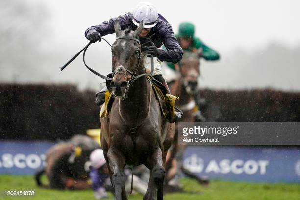 Sam TwistonDavies riding Riders On The Storm clear the last to win The Betfair Ascot Chase as Harry Cobden falls from Cyrnameat Ascot Racecourse on...