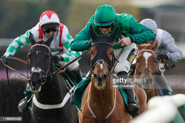 Sam TwistonDavies riding Torpillo clear the last to win The Highflyer Bloodstock Novices' Chase at Warwick Racecourse on November 20 2019 in Warwick...