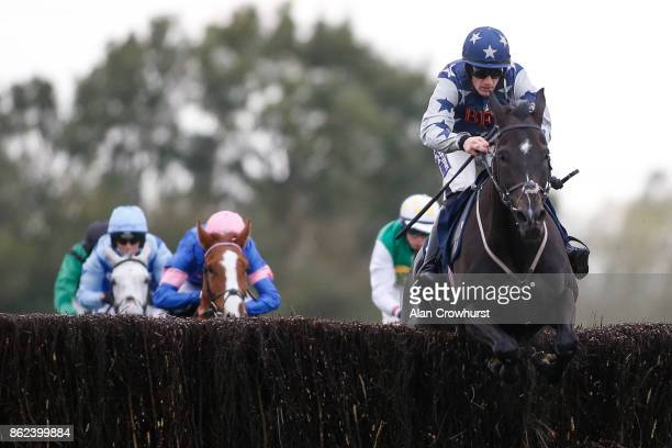 Sam TwistonDavies riding Wicked Willy clear the last to win The 32redcom Steeple Chase at Huntingdon racecourse on October 17 2017 in Huntingdon...