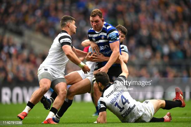 Sam Underhill of Bath Rugby is tackled by Piers O'Connor, Luke Morahan and Luke Daniels of Bristol Bears during the Gallagher Premiership Rugby match...