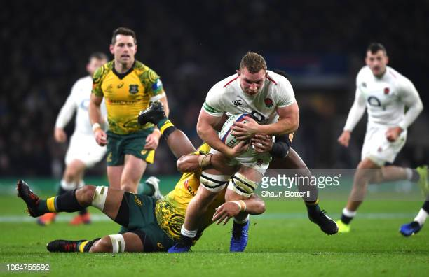Sam Underhill of England is tackled by the Australian defence during the Quilter International match between England and Australia at Twickenham...