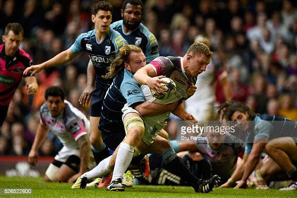 Sam Underhill of the Ospreys scores his try despite the efforts of Kristian Dacey during the Guinness Pro 12 match between Cardiff Blues and Ospreys...