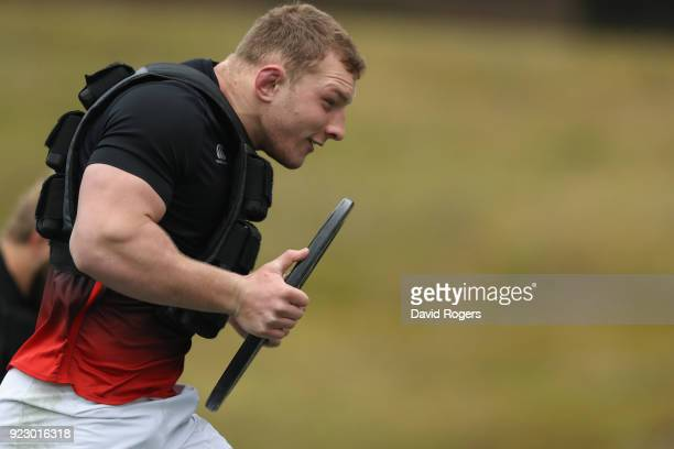 Sam Underhill sprints carrying a weight during the England training session held at Pennyhill Park on February 22 2018 in Bagshot England