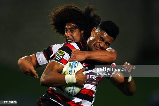 Sam Vaka of Counties Manukau is tackled by Tua Saseve of North Harbour during the round two ITM Cup match between North Harbour and Counties Manukau...