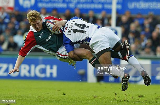 Sam Vesty of Leicester is tackled by Andy Higgins during the Zurich Premiership match between Leicester Tigers and Bath at Welford Road on October 9...