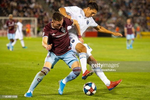 Sam Vines of the Colorado Rapids and Shea Salinas of the San Jose Earthquakes battle for possession during the second half at Dick's Sporting Goods...