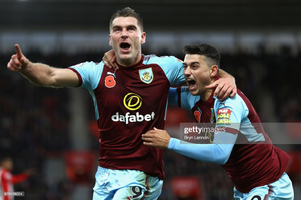 Sam Vokes celebrates scoring his side's first goal with Matthew Lowton of Burnley during the Premier League match between Southampton and Burnley at St Mary's Stadium on November 4, 2017 in Southampton, England.