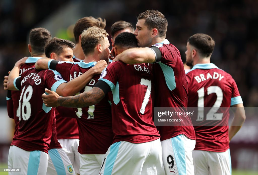 Sam Vokes of Burnley celebrates scoring his sides first goal with his Burnley team mates during the Premier League match between Burnley and West Ham United at Turf Moor on May 21, 2017 in Burnley, England.