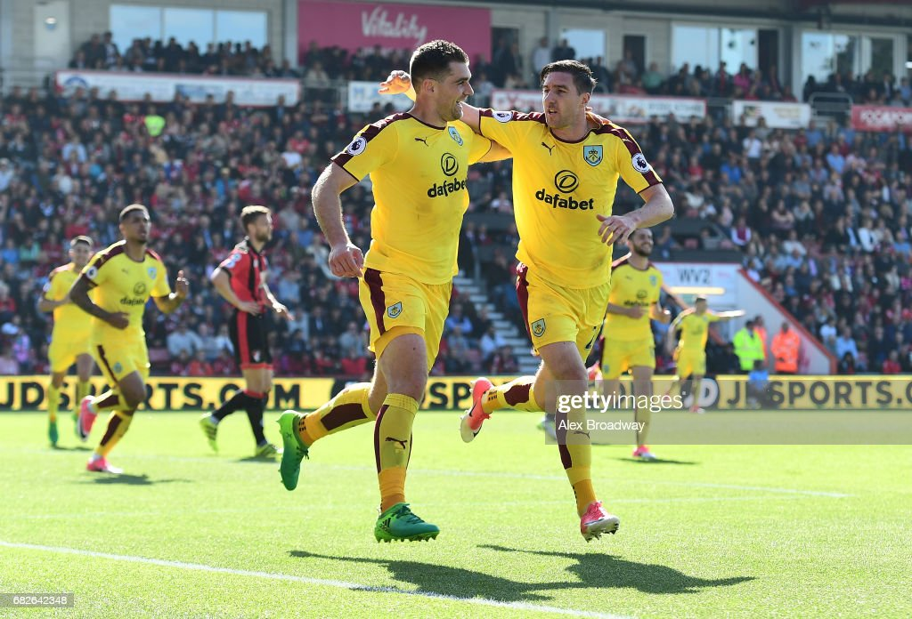 Sam Vokes of Burnley celebrates scoring his sides first goal with Stephen Ward of Burnley during the Premier League match between AFC Bournemouth and Burnley at Vitality Stadium on May 13, 2017 in Bournemouth, England.
