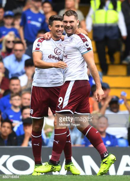 Sam Vokes of Burnley celebrates scoring his sides first goal with Robbie Brady of Burnley during the Premier League match between Chelsea and Burnley...
