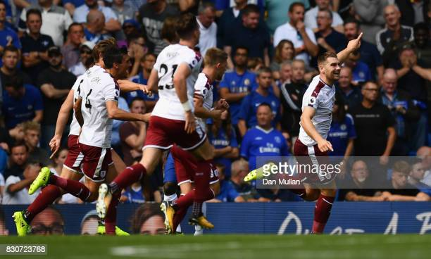 Sam Vokes of Burnley celebrates scoring his sides third goal with his Burnley team mates during the Premier League match between Chelsea and Burnley...