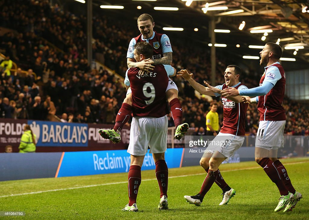 Sam Vokes of Burnley celebrates scoring the equalising goal with Kieran Trippier during the FA Cup Third Round match between Burnley and Tottenham Hotspur at Turf Moor on January 5, 2015 in Burnley, England.